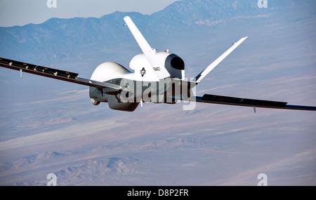 Northrop Grumman MQ-4C Triton unmanned aerial vehicle on the first flight test April 22, 2013 in Palmdale, CA. Triton - Stock Photo