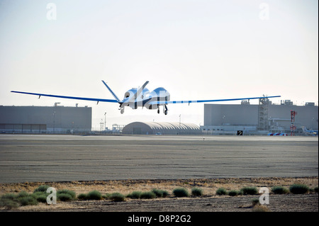 Northrop Grumman MQ-4C Triton unmanned aerial vehicle on the first flight test performs a landing April 22, 2013 - Stock Photo