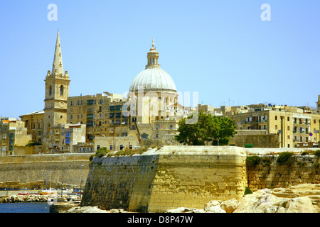 A view from Marsamxett Harbor of St. Andrew's Bastion and St. John's Cathedral at Valletta, Malta. - Stock Photo