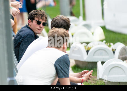 Moscow, Russia, 1st June, 2013. Tom Burke (Citizens! band) sits in front of the scene while Alt-J band performs - Stock Photo