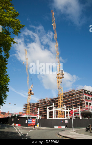 Two construction Liebherr tower cranes at construction site in Chester City - Stock Photo
