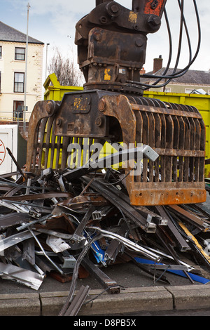 Scrap metal waste of iron and aluminum for recycling at a demolition site - Stock Photo