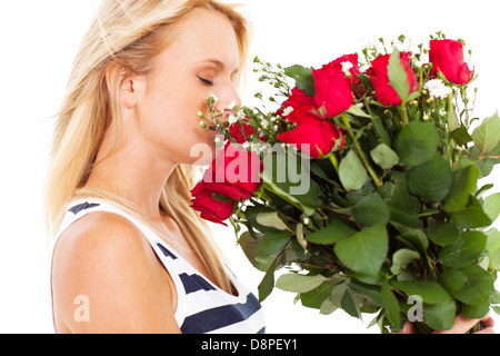 pretty young woman smelling bunch of roses - Stock Photo