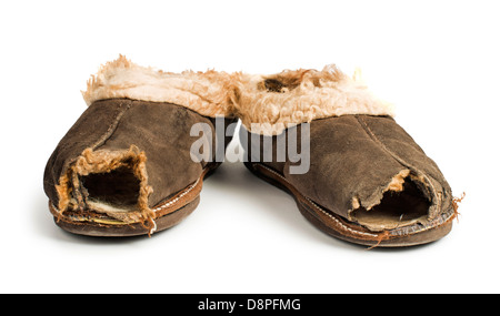 Old torn boots of leather with a hole. - Stock Photo