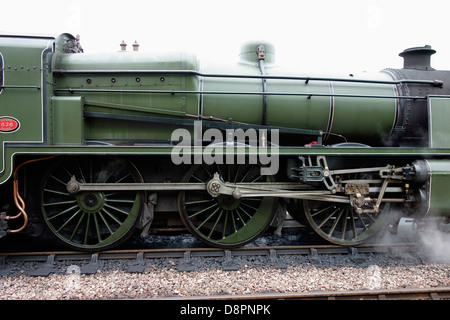 Close up of steam train engine wheels - Stock Photo