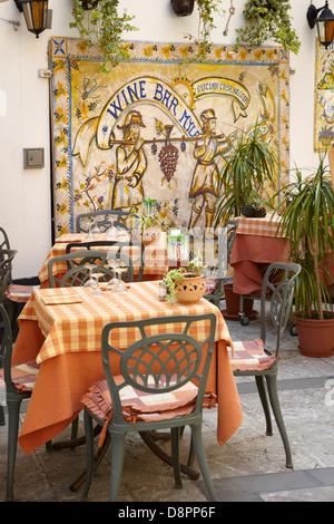 Bar art decoration, Old Town in Taormina, Sicily, Italy - Stock Photo