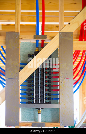 plumbing manifold system PEX tubing for house water distribution - Stock Photo