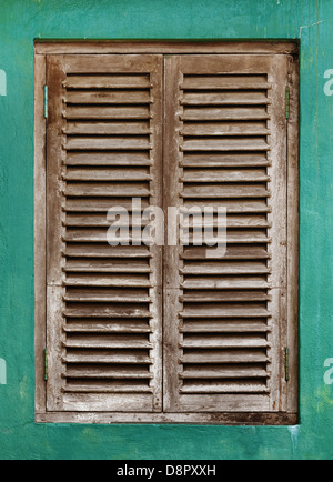 Old vintage window with wooden lattice on green wall - Stock Photo