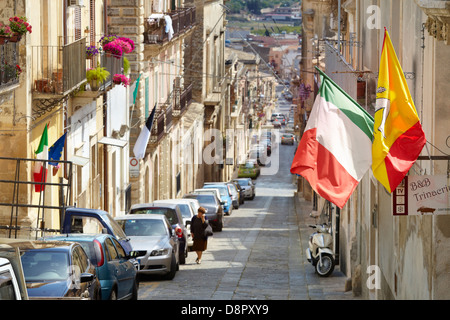 Italian and sicilian flag on the street of Noto town, Sicily, Italy UNESCO - Stock Photo