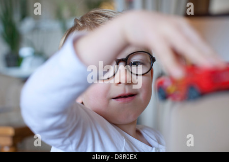 Little boy playing with toy - Stock Photo