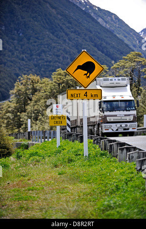 Kiwi caution sign on road to Arthurs Pass in Southern Alps South Island New Zealand - Stock Photo