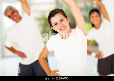 beautiful young teen girl working out with parents at home - Stock Photo