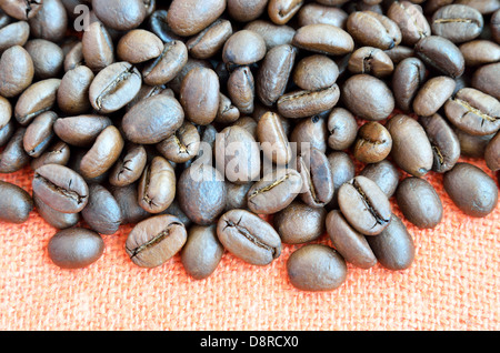 Coffee beans on textile background - Stock Photo