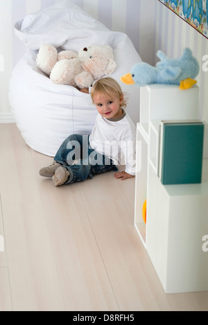 Baby playing in nursery - Stock Photo