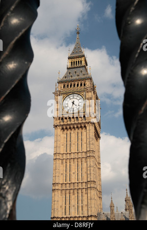 The Elizabeth Tower or Big Ben at the Palace of Westminster, London viewed through the security fence.  May 2013 - Stock Photo