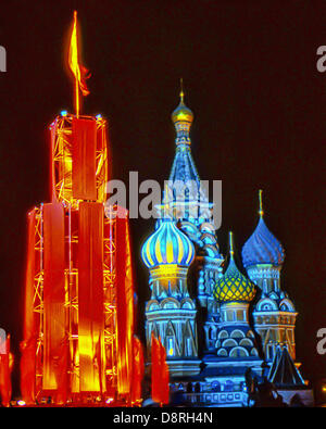 May 1, 1987 - Moscow, RU - Illuminated on the night of the May Day Parade, a tower draped in red stands next to - Stock Photo