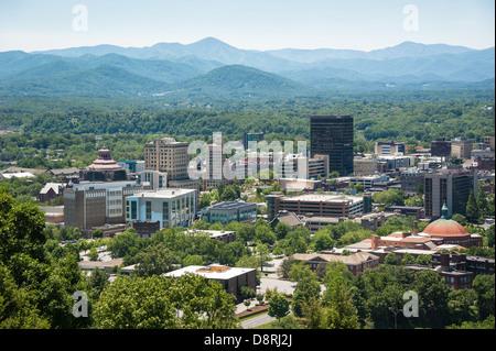 Asheville, North Carolina nestled within the beautiful Blue Ridge mountains. - Stock Photo