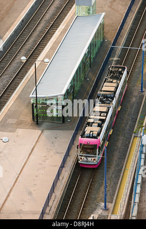 A tram puling in to Snow Hill station. Birmingham, West Midlands, England, UK - Stock Photo