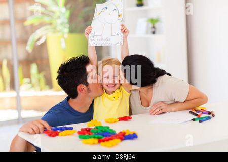 Kiss of love happy parents with their cute baby girl stock photo happy parents kissing cute little daughter with her drawing stock photo thecheapjerseys Image collections