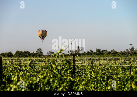 Colorful hot air balloons in flight over wine country at the Temecula Balloon and Wine Festival - Stock Photo