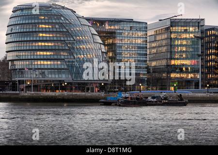 City Hall on the South Bank at dusk,Southwark,London,England - Stock Photo