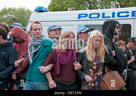 Group of young UAF ( Unite Against Fascism ) protesters linking arm to prevent being moved on by police. 1 June - Stock Photo