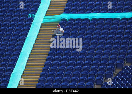 Cardiff, Wales, UK. 4th June 2013. A lone fan sits in the stand reading a newspaper during the ICC Champions Trophy - Stock Photo