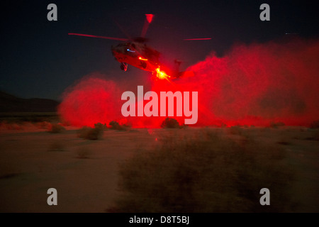 An HH-60H Sea Hawk helicopter assigned to the Firehawks of Helicopter Sea Combat Squadron (HSC) 85, lands in a designated - Stock Photo