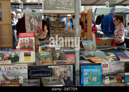 Second hand used books for sale at flea market at the St. Jacobs square in Ghent, Belgium - Stock Photo