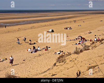 Southport, UK. 4th June, 2013. Sun Worshippers today enjoying the rare hot sunny day at Formby Beach, Southport, - Stock Photo