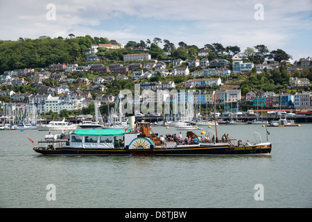 The terraced houses of Kingswear make an appropriate backdrop for the Paddle Steamer Kingswear Castle on the River - Stock Photo