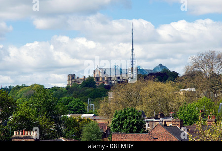 The famous Alexandra Palace looks down over houses in Wood Green, a suburb in Haringey, north London - Stock Photo