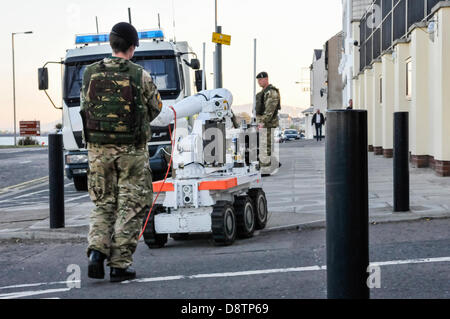 Carrickfergus, Northern Ireland. 4th June, 2013. A soldier from EOD-11 squadron (the Bomb Squad) remotely controls - Stock Photo