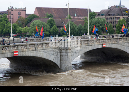FC Basel flags on the Rhine river in Basel, Switzerland. The bridge is called the Mittlere Brücke, or Middle Bridge. - Stock Photo