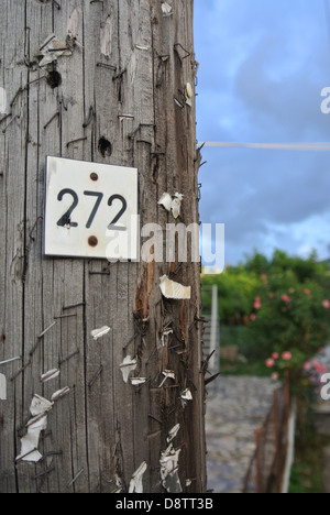 An aging overused wooden post in Kassiopi; Corfu, Greece. - Stock Photo