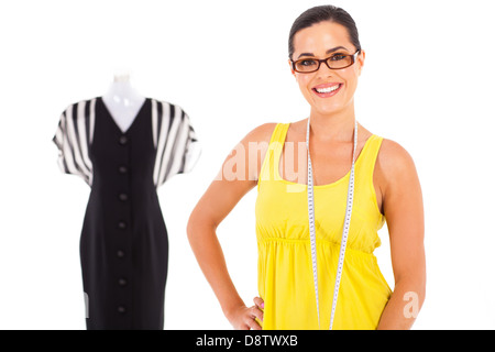 happy young female dressmaker portrait on white with mannequin in background - Stock Photo