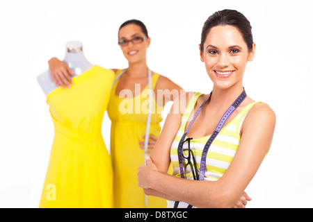 beautiful young female tailors portrait on white