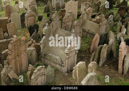 Old gravestones at the Old Jewish cemetery Josefov district in Prague Czech Republic - Stock Photo