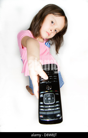 Asian child with remote control - Stock Photo