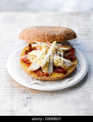 Chicken,ham and crisp apple bagel sandwich - Stock Photo