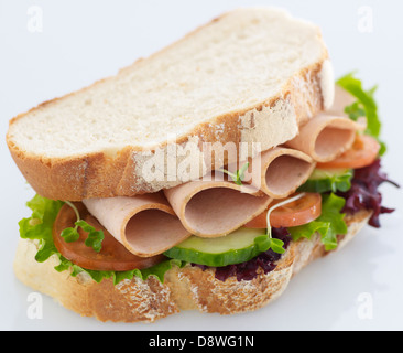 Ham salad sandwich bread crusts tomatoes cress cucumber - Stock Photo