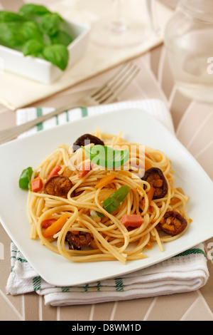 Spaghetti with turkey meat and Chinese mushrooms. Recipe available. - Stock Photo