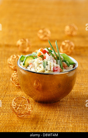 Curried rice salad with crab meat - Stock Photo
