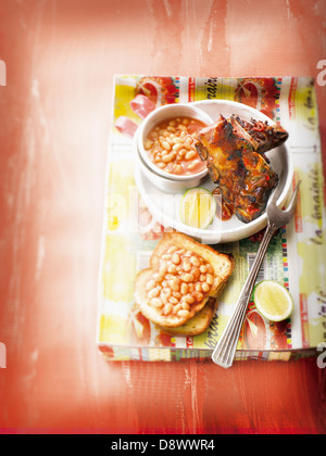 Spare ribs with baked beans in tomato sauce - Stock Photo