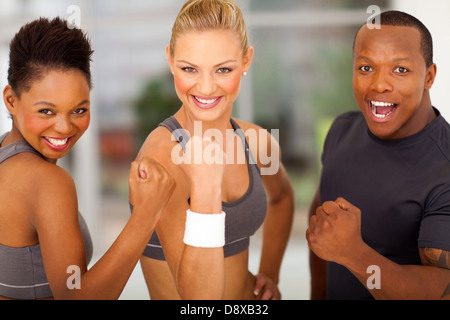 exciting group of fit people waving fist - Stock Photo