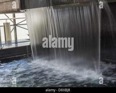 curtain of water inside shaw conference centre - Stock Photo