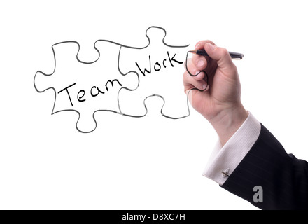 drawing pieces of a puzzle with team work text isolated on white - Stock Photo