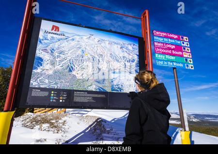 Snow boarder and Trail map, Mammoth Mountain Ski Area, Mammoth Lakes, California USA - Stock Photo