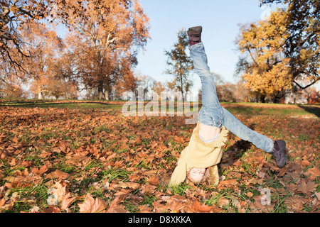 Six year-old girl doing a cartwheel - Stock Photo