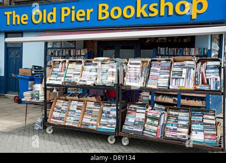 Racks of books outside secondhand bookshop Morecambe Lancashire England UK United Kingdom GB Great Britain - Stock Photo